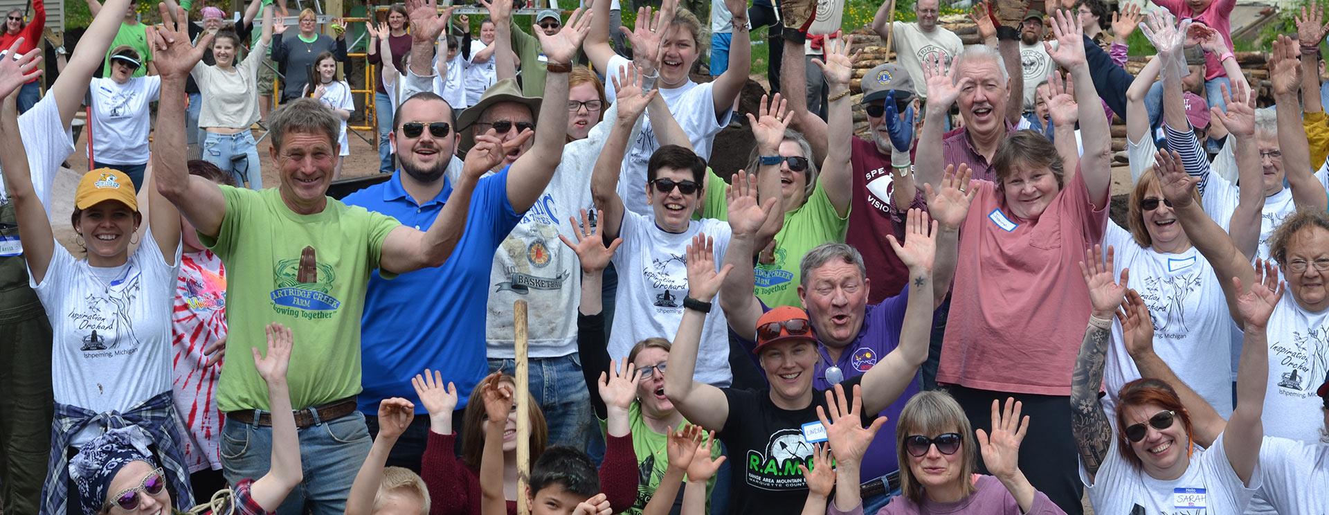 volunteers-cheering-banner